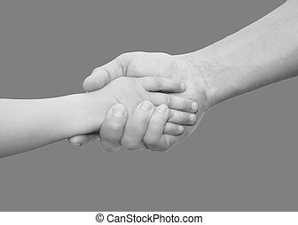 hands of father and son on a gray background
