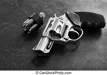 Powerful Handgun and Bullets - Closeup of powerful handgun...
