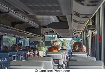 View from inside the bus with passengers