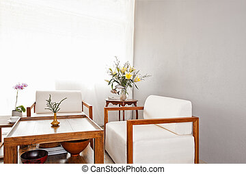 Bright white seater in lounge area
