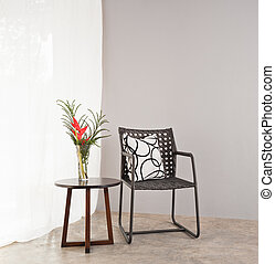 Garden furniture chair in simple setting and side table