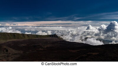 Fast clouds forming on a volcano - forming clouds at the...