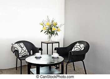 Garden furniture chairs in simple setting and coffee table