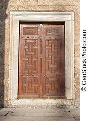 Wooden door with ancient floral patten. Wood carving technic