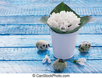 Easter background with eggs and snowdrops - Snowdrops and...