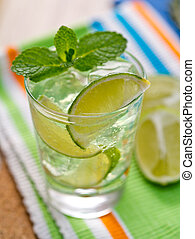 Summer mojito - Mojito cocktail with wedges of lime and mint...