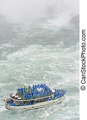 Tourists near the Niagara Falls - Maid of the Mist Tour boat...