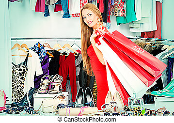 ladys sale - Fashionable girl shopping in a store