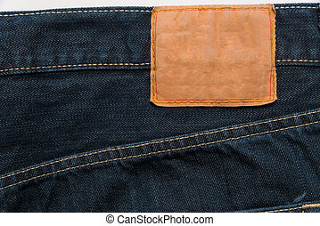 Blue denim jeans with label as a background