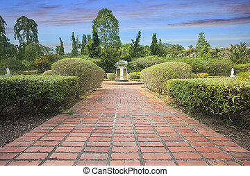 Formal Garden Brick Path with Trees Plants and Water...