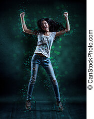 Young woman dancing - Attractive young woman dancing, hair...
