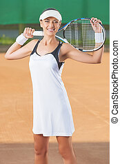 Smiling Professional Female Tennis Player At Court