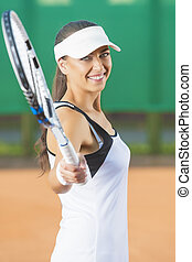 Woman Playing Tennis at Court and smiling - Professiona...
