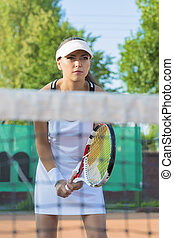 Professional Female Tennis Player Concentrated on Court...