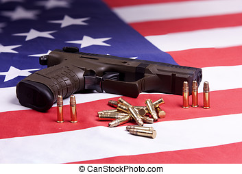 Pistol and ammo on flag. - A conceptual image of a pistol...