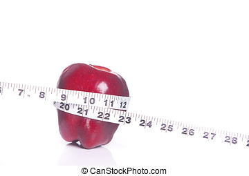 Red apple and tape measure - A concept image of an apple...