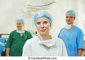 surgeons team in surgery operation room - Team of surgeon in...