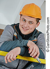 happy electrician worker - Happy young adult electrician...