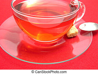 Tea cup with rose hip tea on a placemat