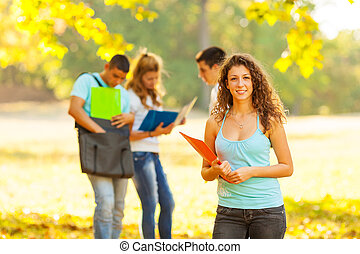 Students at park - Student at park. Selected focus on the...