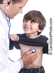 Check up - Young handsome Caucasian boy smiles at doctor in...