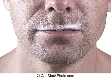 Milk stache - Macro closeup of lower half of man's face with...
