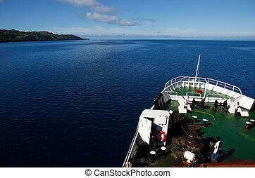 Big ship going along Vanua Levu island, Fiji, South Pacific