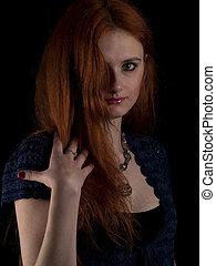 Red-haired beauty - Beautiful red-haired young lady in...
