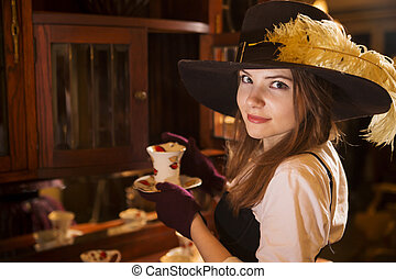 Zoomed woman at dress with porcelain cup - Zoomed woman at...