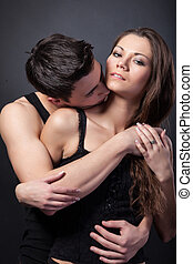 Happy young couple hugging First love on dark background