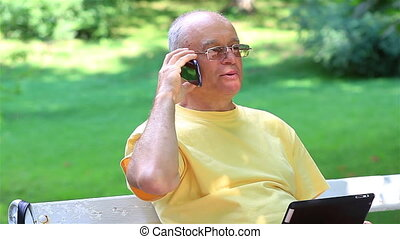 Senior man talking on smart phone