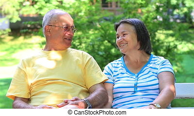Senior couple relaxing together in city park