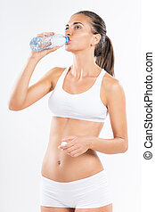 Morning hydration - Cute young woman with underwear drinking...