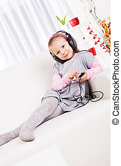 Little girl listening music - Cute little girl listening...