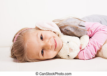 Little girl with soft toy - Cute little girl hugging soft...
