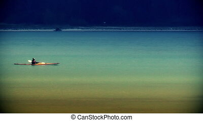 Kayak rower at sunset