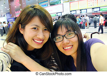 Asian friends with lovely smile