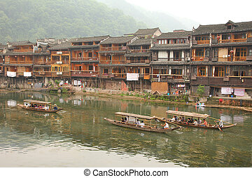 Fenghuang ancient town in China - FENGHUANG - MAY 12: Wooden...