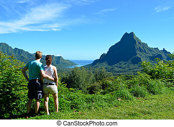 Couple in French Polynesia - Young honeymoon couple with an...