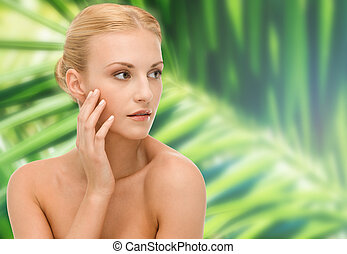 beautiful woman touching her face skin - beauty and spa...