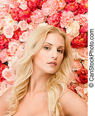 beautiful woman and background full of roses - beauty and...