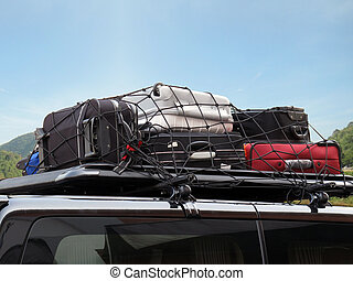 journey - luggages over the car roof for a trip