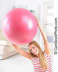 Woman with gym ball - Beautiful young woman with gym ball...