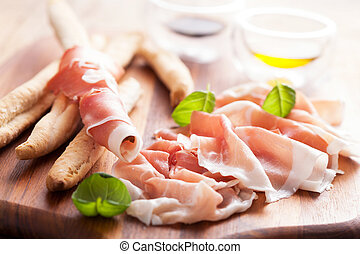 parma ham and grissini bread sticks