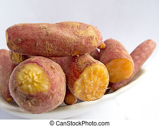 sweet potatoes on plate - Heap of cooked sweet potatoes on...