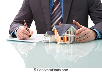 Purchase agreement for house - Man signs purchase agreement...