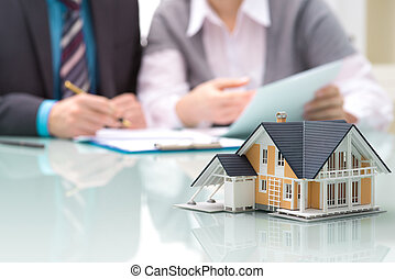 Real estate concept - Businessman signs contract behind home...