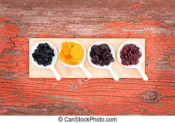 Assorted dried berries and fruit in ramekins - Overhead view...