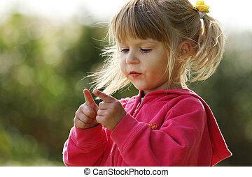 beautiful little girl playing in nature - a beautiful little...