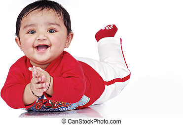Infant 6-8 month - baby lying with soft toy